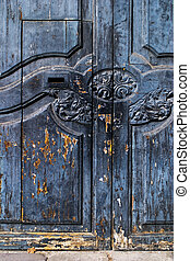 Rustic Spanish door with flaking paint - An old fashioned...