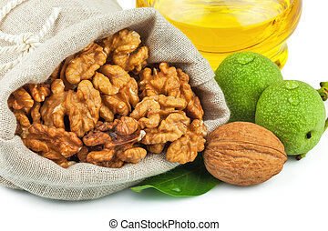 Macro view of purified walnut in flax sack and glass bottle of oil isolated on white background