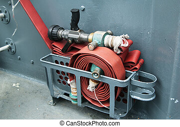 Fire hose on a deck of the ship