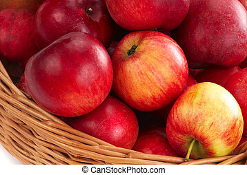 Basket with apple - 2 - Harvesting. A basket with red ripe...