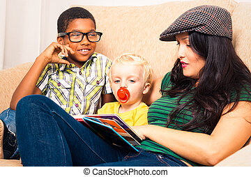 Woman and children reading book - Young happy woman with...