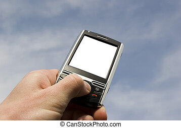 smartphone - hands with communicator isolated over blue...