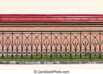 Wrought-iron fence - Ornate wrought-iron fence against a...