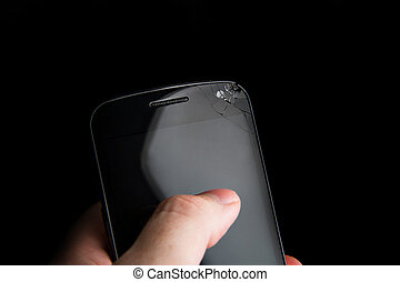Chipped display on a smart phone - Man holding a smartphone...