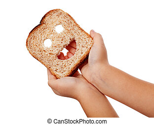 Sharing food - child hands holding happy bread slice,...