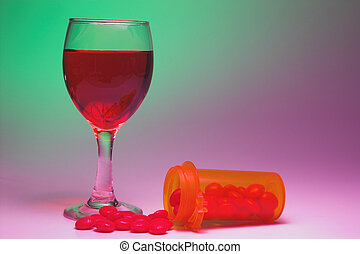 Drugs and Alcohol - A glass of wine and a bottle of pills