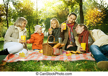 Happy Big Family in Autumn Park Picnic