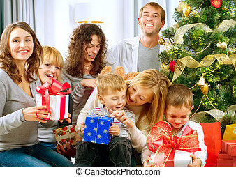 Happy Big family holding Christmas presents at homeChristmas...