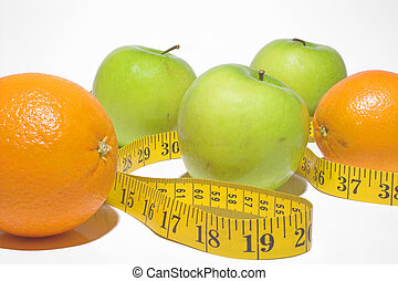 Weight Loss Concept - A tailors tape snaking through apples...