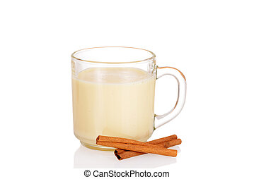 Fresh mug of eggnog with cinnamon sticks
