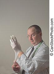 Proctologist - A proctologist preparing for a patient...