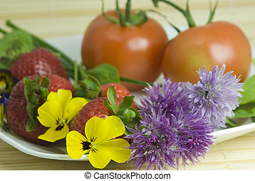 edible flowers - salad plate with tomatoes, edible flowers,...