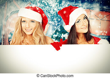 young women - Two sexy young women in Christmas clothes...