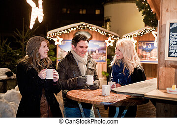 Young People on a Christmas Market - Young People have fun...