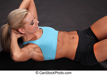 Woman Sit-ups - An attractive young female woman in black...