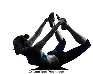 woman exercising yoga bow pose - one caucasian woman...