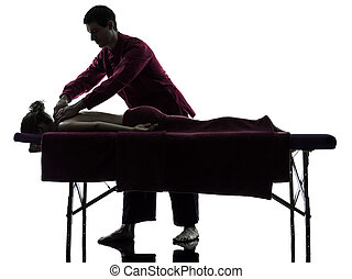 back massage therapy - man woman back massage in silhouette...
