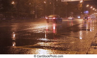 cars go in the rain time lapse - cars go at night in the...