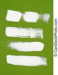 White brush strokes on green background