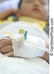 Child intravenous fluid - Intravenous fluid line at left arm...