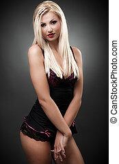 Beautiful blond woman wearing black lingerie