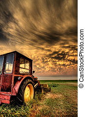Storm Clouds Saskatchewan with antique vintage tractor