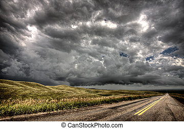 Storm Clouds Saskatchewan billowing clouds an dpaved road