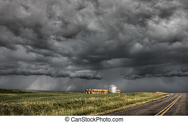 Storm Clouds Saskatchewan billowing clouds and paved road