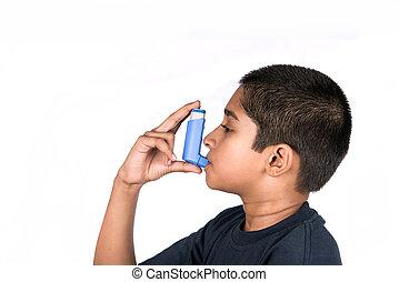 Asthma - Close up image of a cute little boy using inhaler...