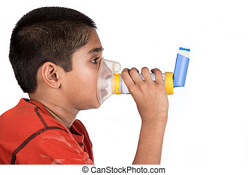 Asthma - Close up image of a cute little boy using inhaler...