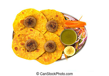 Roti - A roti and side sdish isolated on white background