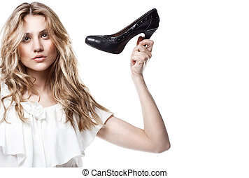Fashion studio shot of shopping girl holding a black high...
