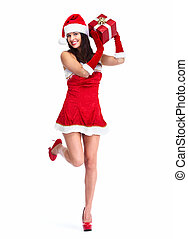 Santa helper Christmas girl with a present. - Beautiful...