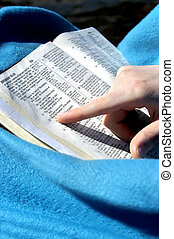 Biblical Prophecy - Young female is wrapped in a blue...