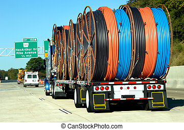 Arkansas delivery - Big rig hauls spindles of multi-colored...