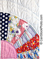 Homespun - Grandmas quilt has cotton pieced fabric forming a...