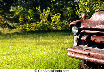 Rusty Chevy - Abandoned and junked Chevy truck sits in a...
