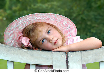 Aglow in Pink - Lost in thought, beautiful little girl leans...