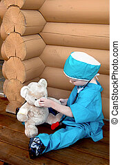 Physician Role Play - Little boy pretends to fix his teddy...