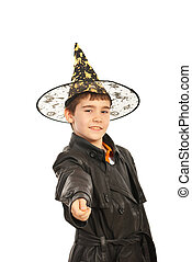 Trick or treat - Boy in black jacket and witch hat asing for...