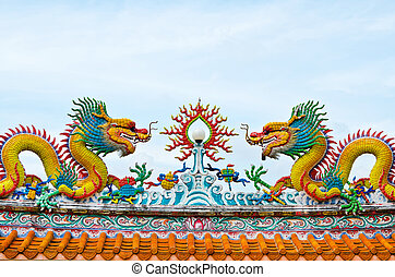Statue of twin dragons on the roof of Chinese temple