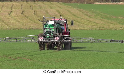 tractor spray autumn green crop