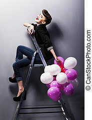 Pretty cheerful fashion retro teen girl laughing on ladder -...
