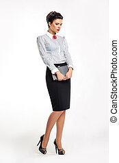Thoughtful business lady in fashion skirt and blouse with...