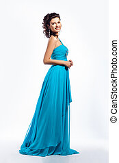 Feminine. Gorgeous graceful smiling brunette girl in blue dress