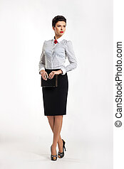 Confident entrepreneur woman in business suit in office -...