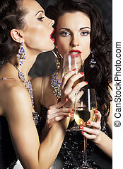Women - happy new year with wineglasses of champagne -...