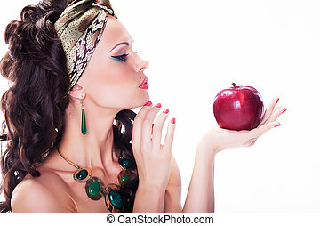 Beautiful oriental woman with red apple - organic natural...