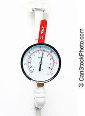 Pressure Gauge - An pressure meter build on white wall.