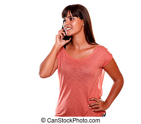 Charming young woman talking on cellphone